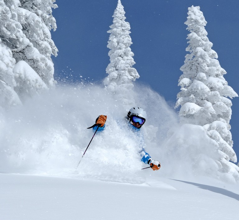 Skier Enjoys Chest High Powder In Steamboat Springs, Colorado
