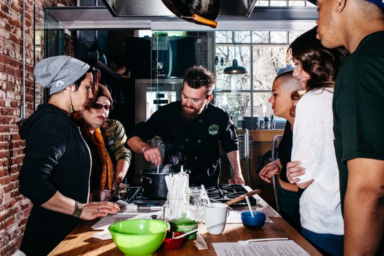 Tourists Watch Chef Travis French During A Cannabis Cooking Class, Part Of A My 420 Tours In Denver.
