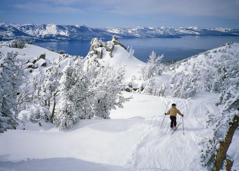Skier In Fresh Snow Above Alpine Lake Tahoe