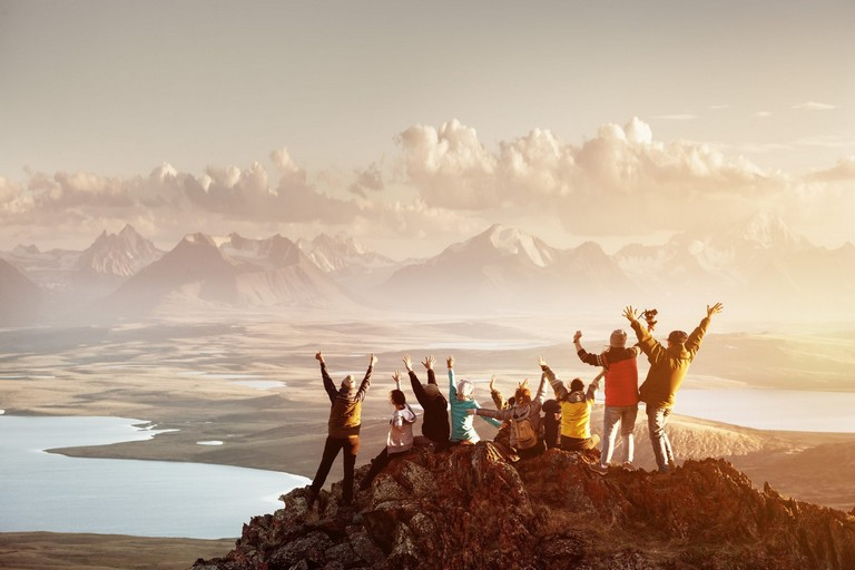 Big Group Of People Having Fun In Success Pose With Raised Arms
